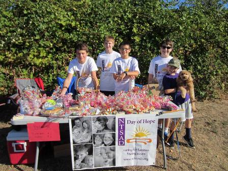 family raising funds with a bake sale